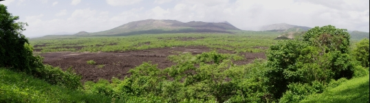 Panoramic view to the volcano from the forest reserve.