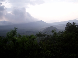 View of the smoking volcano in the morning fog